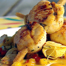 Sugarcane Skewered Sea Scallops with Mango Hearts of Palm Slaw and Scotch Bonnet Sugarcane Syrup