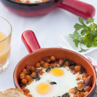 Hearty Eggs with Harissa Spiced Chickpeas and Mixed greens