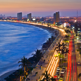 Mazatlan Twilight by John Matzick - City,  Street & Park  Skylines ( shore, skyline, malecon, mazatlan, apartment, ocean, cityscape, architecture, road, beach, coastline, exotic, cityscape night, coast, historic, city, lights, sunny, colonial, gold, tall, downtown, nightlife, water, sand, highrise, building, spanish, exotic beach, mexico, penthouse, neighborhood, night city, aerial, urban, condominium, tower, vacation, night, high-rise, high, town, view )