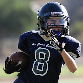 #8 coming through by Kevin Mummau - Sports & Fitness American and Canadian football ( pop warner, touchdown, determination, focus, #8, cut, running )