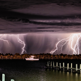 Fishing can wait by Craig Eccles - News & Events Weather & Storms ( thunder, lightning storm, lightning, lightning bolt, thunder bolt., weather, thunder storm, ocean, jetty, beach, storm, boat )