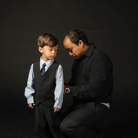 Father and son by Michael Bentsen - People Family ( studio, black clothes, preparation, son, black, father )