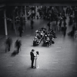 A moment in the crowd by Dewan Demmer - Wedding Bride & Groom ( london wedding, station wedding photography, st pancras station, slow shutter photography )