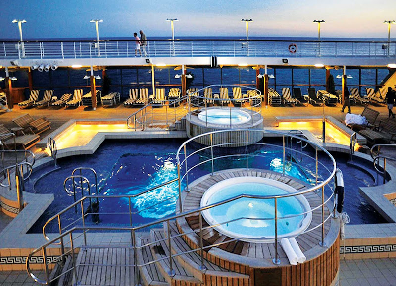 Oceania Regatta's large heated pool and whirlpool spas are the ideal location to unwind and enjoy your travels.