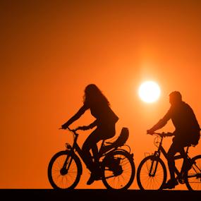 Cycling at sunset by Yuval Shlomo - Sports & Fitness Cycling