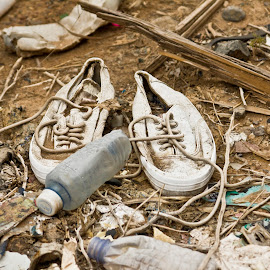 . by Krystle-lee Dodson - News & Events Politics ( shoes, dirty, litter, garbage, tragic, plastic, bottle, object,  )
