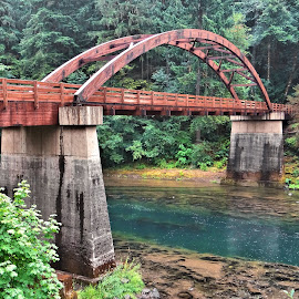 Umpqua River Bridge by Nick Crawford - Buildings & Architecture Bridges & Suspended Structures ( calm, greens, arch, pathway, beautiful, image, landscape, pretty, picture, wooden, reds, serene, path, walkway, bridge, umpqua, river )