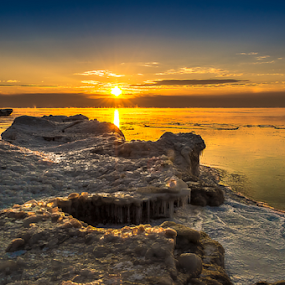 Long Cold Winter III by James Meyer - Landscapes Waterscapes ( iceberg, jamesmeyerphotography, lake michigan, sunset, ice, yourhomeport, frozen lake, seascape, sunrise, port washington, frozen, photography )