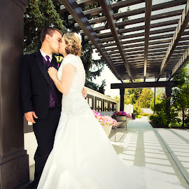 Stealing Kisses by Dustin Olsen - Wedding Bride & Groom ( temple, wedding photography, kissing, wedding, summer, bride and groom )