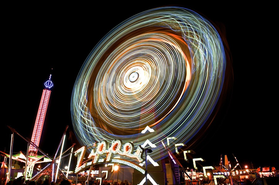 Tilted Zipper by Roy Walter - City,  Street & Park  Amusement Parks ( lights, rides, amusement park, park, county fair, night, city )