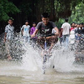 play  by Suguresh Sultanpur - News & Events Weather & Storms ( cycling, water fall, boy )