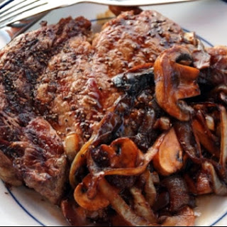 Ribeye Steak with Espresso Balsamic, Caramelized Onions & Mushrooms Recipe - EVOO Market Fort Lauderdale