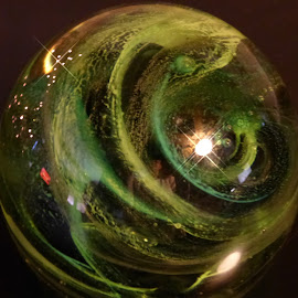 Reflections Of Light And Photographer  by Annette Long-Soller - Artistic Objects Glass ( abstract, ireland, and ref. of photographer, green swirls, paperweight, reflections of lights )