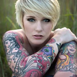 Mesmerized by Kelly Thompson Edwards - People Body Art/Tattoos ( field, aladdin's lamp, woman, depth of field, belly dancer, blue eyes, beauty, tattoo )