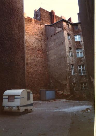 A bleak courtyard behind a tenement block in East Berlin