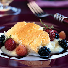 Meyer Lemon Buttermilk Pudding Cake with Fresh Berries