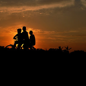 Friendship   by Abhishek Mandal - People Street & Candids ( returning, cycle, silhouette, boys, dusk, Bicycle, Sport, Transportation, Cycle, Bike, ResourceMagazine, Outdoors, Exercise, Two Wheels, Emotion, portrait, human, people )