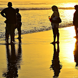 on the beach by Yudi Dhaniwanto - People Family ( family silhouette )