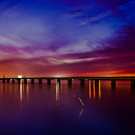 After Sunset on Biloxi Bay  by Jim Howton - Landscapes Sunsets & Sunrises ( lights, biloxi, bay, colors, sunset, long exposure )