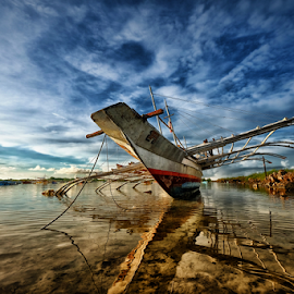Retired by Ferdinand Ludo - Transportation Boats ( destroyed, cebu city, but retired, repairable, cordoba, fishing boat )