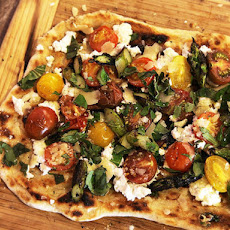 Grilled Pizza With Grilled Tomatoes, Asparagus, Goat Cheese, and Marcona Almonds