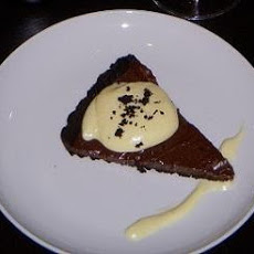 Dark Chocolate Tart With Bacon and Whipped Almond Pastry Cream