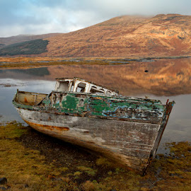 A nice place to rest by Ian Pinn - Transportation Boats ( scotland, winter, mountain, wreck, loch, mull, boat )