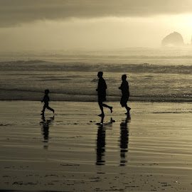 silhouette family by Dan Riddle - People Family ( waves, family, silhouette, beach, landscape )