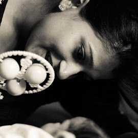 Play time by Savneet Kaur - People Family ( child, rattler, mother, black and white, toys, newborn )