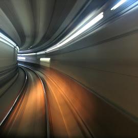 Speeding through the tunnel by Chrissy Almaraz - Transportation Railway Tracks