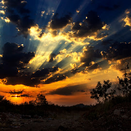 The God's Rays by Vipin Waghmare - Landscapes Cloud Formations ( blue, rays of god, orange. color, sunrays, sunrise, landscape, making the way through clouds )