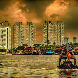 fire in the sky by Maricha Knight van Heerden - City,  Street & Park  Skylines ( saigon river, ho chi ming city, storm brewing, sunset, boats )