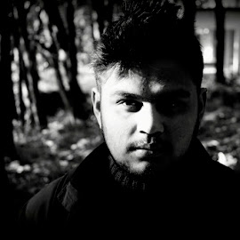 Black & White by Akshay Shah - People Portraits of Men ( face, black and white, shadow, trees, forest )