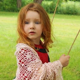 Wild Hair From Swinging by Cheryl Korotky - Babies & Children Child Portraits ( red hair, wild hair, a heartbeat in time photography, amazing faces, blue eyes, beautiful children, swinging on swings, child model nevaeh, knit shawl, red head, portrait, red, green )