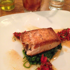Salmon with baby spinach and tapenade
