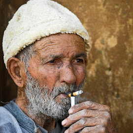 by Szymon Barylski - People Portraits of Men ( cigarette, smoking, old man, morocco, portrait, man )