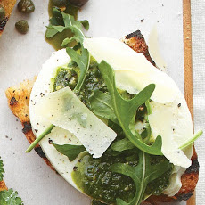Mozzarella, Pesto, Arugula, and Parmesan Bruschetta