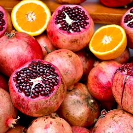 by Adnan Choudhary - Food & Drink Fruits & Vegetables ( orange, fruit, pomegranate, street vendor, vendor, street )
