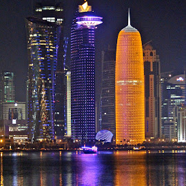 Lights and reflections by Nashira Usef - City,  Street & Park  Skylines ( water, office, skyline, building, reflection, sea, qatar, cityscape, city, bay, doha, corniche, light )