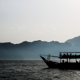 The Black Boat by Muhib Al Abed - Landscapes Travel ( water, mountain, sea, travel, boat, black )