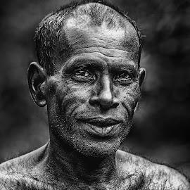 Man by Buddhika Jayawaredana - People Portraits of Men ( black and white, people, portrait, man, human )