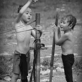 camping time by Candra Matta - Babies & Children Children Candids ( black and white, play, children candids, couple, rain )