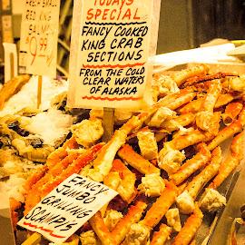 Alaska King Crab legs and jumbo scampis by Robert Briggs - Food & Drink Meats & Cheeses ( alaska crab, seafood vendor, seafood, king crab legs, crab legs crab scampi, fresh seafood )