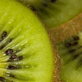 Kiwi by George Holt - Food & Drink Fruits & Vegetables ( sections, fruit, green, kiwi, sliced, three, black )