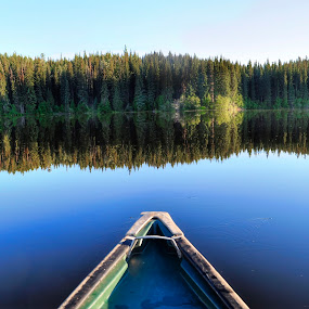 Canoeing on Lonely Lake by Skye Ryan-Evans - Landscapes Waterscapes ( boating, water-sports, nature-scene, scenic photography, paddling, recreational activities, canoe on a lake, canoe, blue water, blue-lake )
