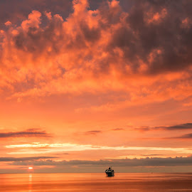 sunset boat by Nathalie Gemy - Landscapes Sunsets & Sunrises ( clouds, orange, sunset, sea, boat, sun )