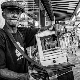 The Fortune Teller  by Samy St Clair - People Portraits of Men ( bird, periquito do realejo, fortune teller, black and white, parrot, candid, liberdade, portrait, street photography,  )