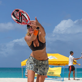 Beach Tennis - Sand Beach Tennis in Paradise - ARABA BTA Competition  by Tony Filson - Sports & Fitness Tennis ( skirt, water, clouds, sand, bta, racket, aruba, yellow tent, beach sports, ocean, beach, sunglasses, cut abs, female, beach tennis association, beach tennis, green tent, athletic )