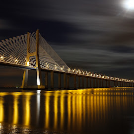 Vasco da Gama Bridge by Andre Guerra - Buildings & Architecture Bridges & Suspended Structures ( tejo, lights, clouds, vasco, gama, night, bridge, lisbon, portugal, river )