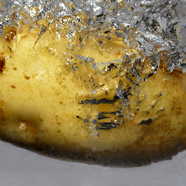 Drop in the spud! by Allan Benson - Food & Drink Fruits & Vegetables ( water, dropped, bubbles, potato, spud )